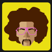 man with curly hair wearing pink glasses